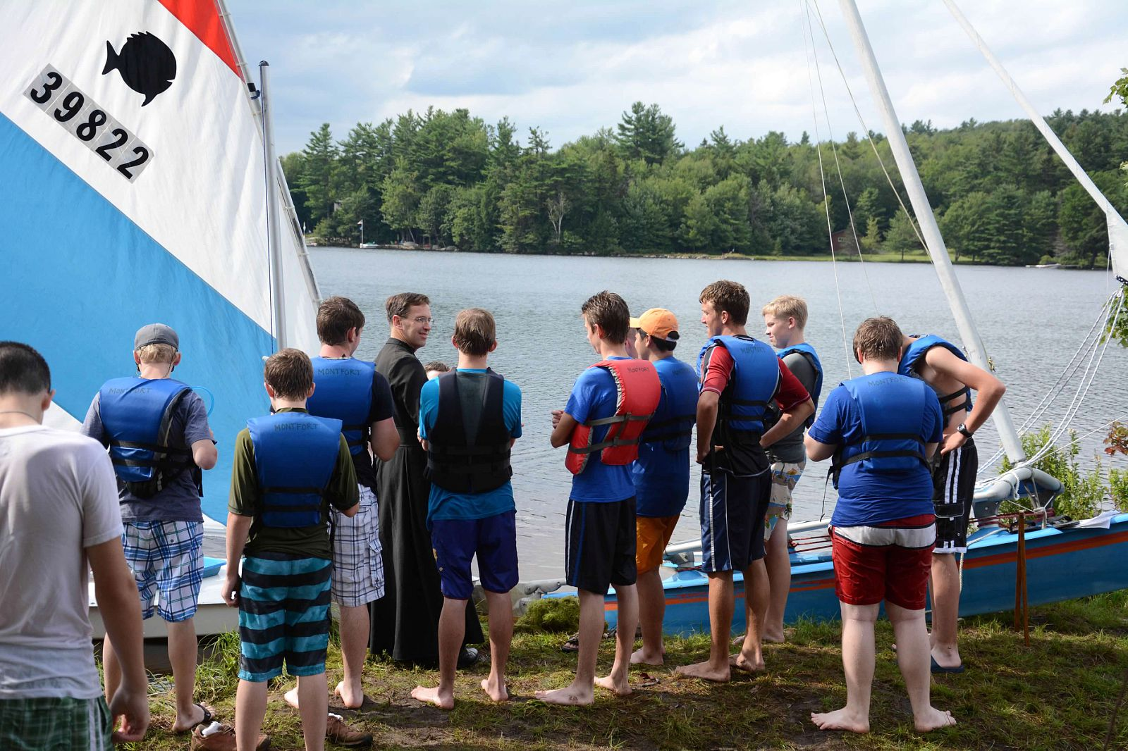 A Brother instructs Montfort campers in sailing