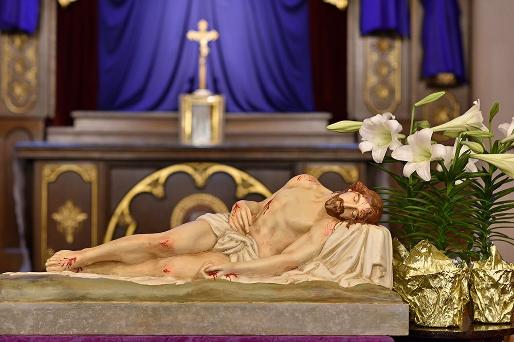 Statue of Christ in death displayed on Good Friday.