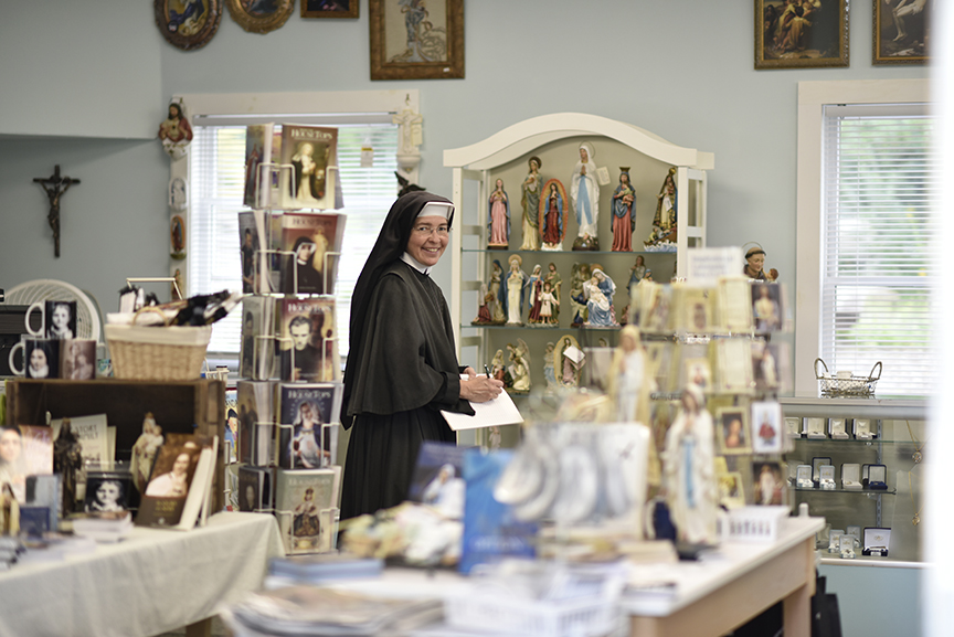 A Sister works in the monastery gift shop.