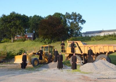 Brothers MICM near construction equipment for IHM School expansion.