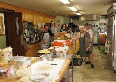 Volunteers help make apple pies for the IHM Bazaar.