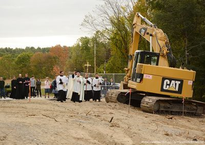 Father blesses where the new wing will be built.