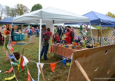 Parents run booths at annual bazaar for school fundraiser.