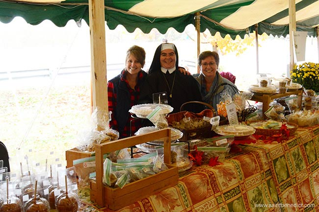 Volunteers help out at the Baked Goods booth of IHM Bazaar