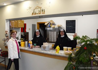 Sisters in concession stand at MacIsaac Hall