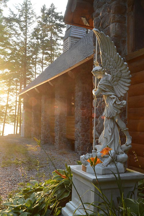 Saint Michael Statue at sunset near Chapel