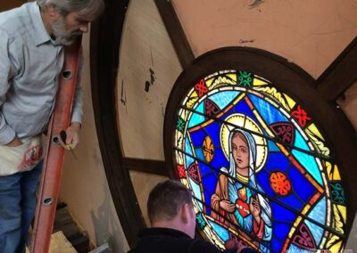 Reinstalling the stained glass panes.