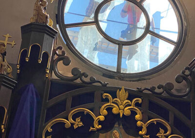 Removing the old frame for the rose window.