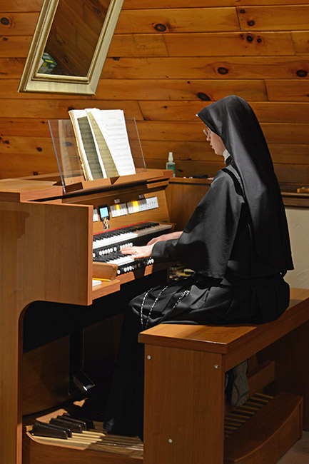 Sister plays the new organ in IHM Chapel