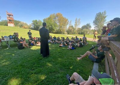 Brother Matthew talks to campers