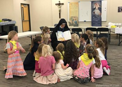 Sister Magdalene reads to campers